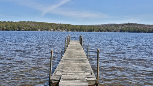 View of dock and Mascoma Lake from beach.