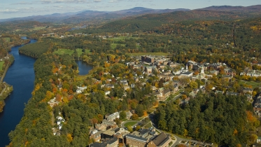 aerial view of campus looking north up the river with mountains in the background