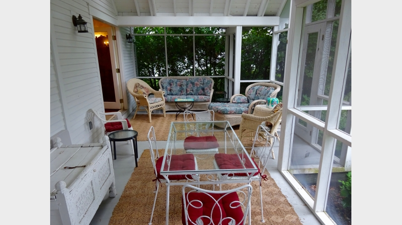 The back porch has both seating (lounging) space, and a small dining table that can be extended with a collapsing table.