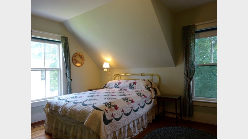 The second bedroom has a queen sized-bed and two windows