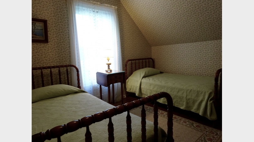 The third bedroom has two twin beds and looks out over the garden.