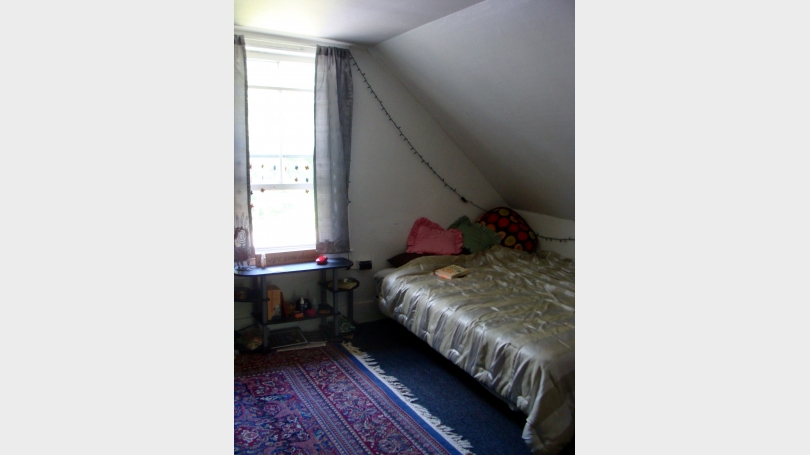 Bedroom and north window of 14 cottage
