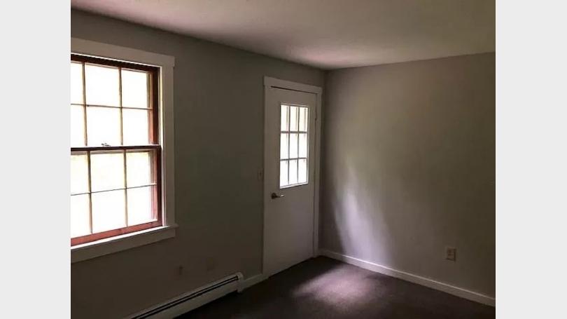 Rear bedroom door to outside deck area