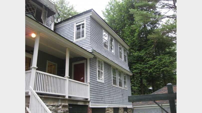 Exterior image of the rental property includes porch