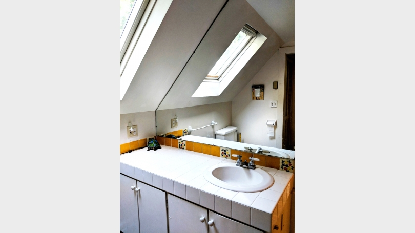 bathroom sink mirror skylight.and toilet