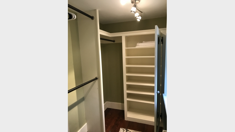 Walk-In Closet with storage shelves