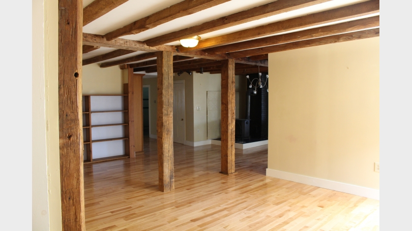 Living Room with exposed beams, hardwood floors