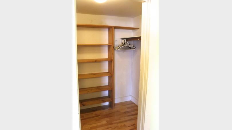 Walk-in closet in larger bedroom