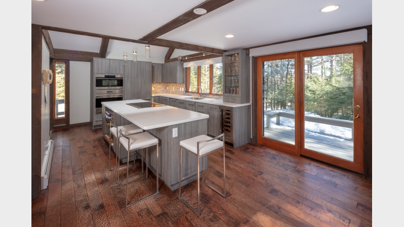 Interior photo of gourmet kitchen and slider to deck.