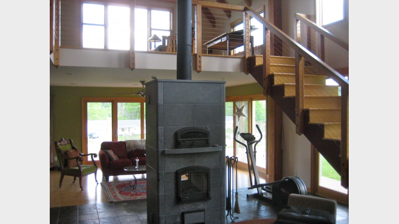 Tulikivi soapstone fireplace and a view of the upstairs loft