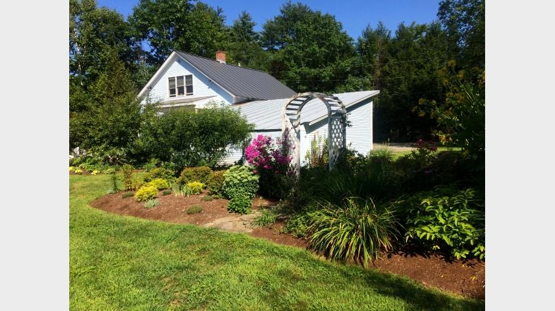 Floral garden behind garage